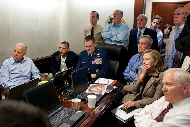 President Obama, Vice President Biden, Secretary Clinton, and members of the national security team receive an update on the mission against Osama bin Laden in the Situation Room of the White House.
