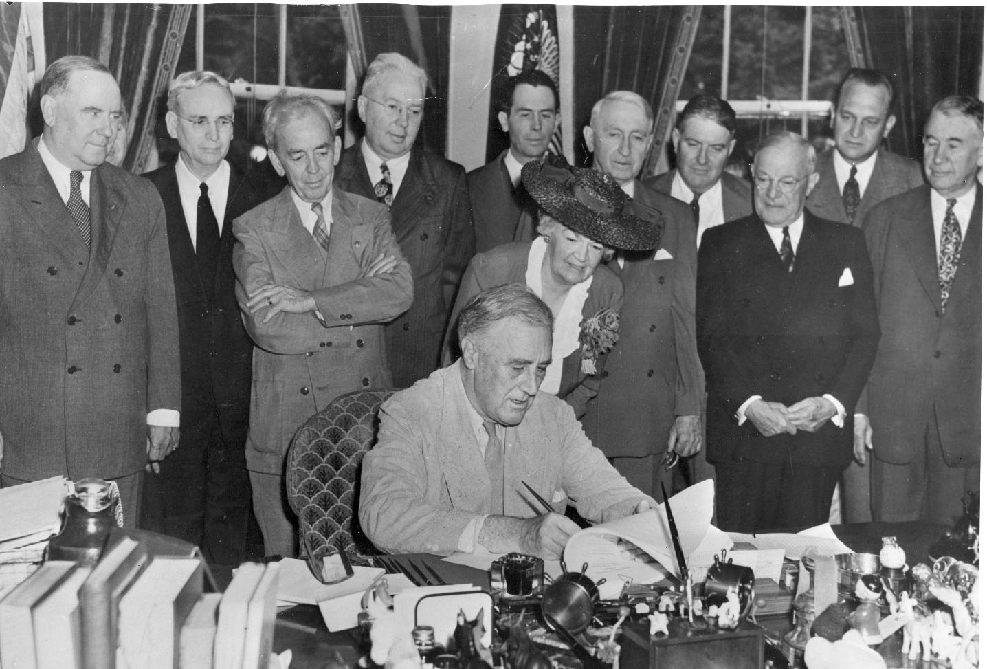 More details President Roosevelt signs the G.I. Bill into law on June 22, 1944 in the Oval Office while others look on