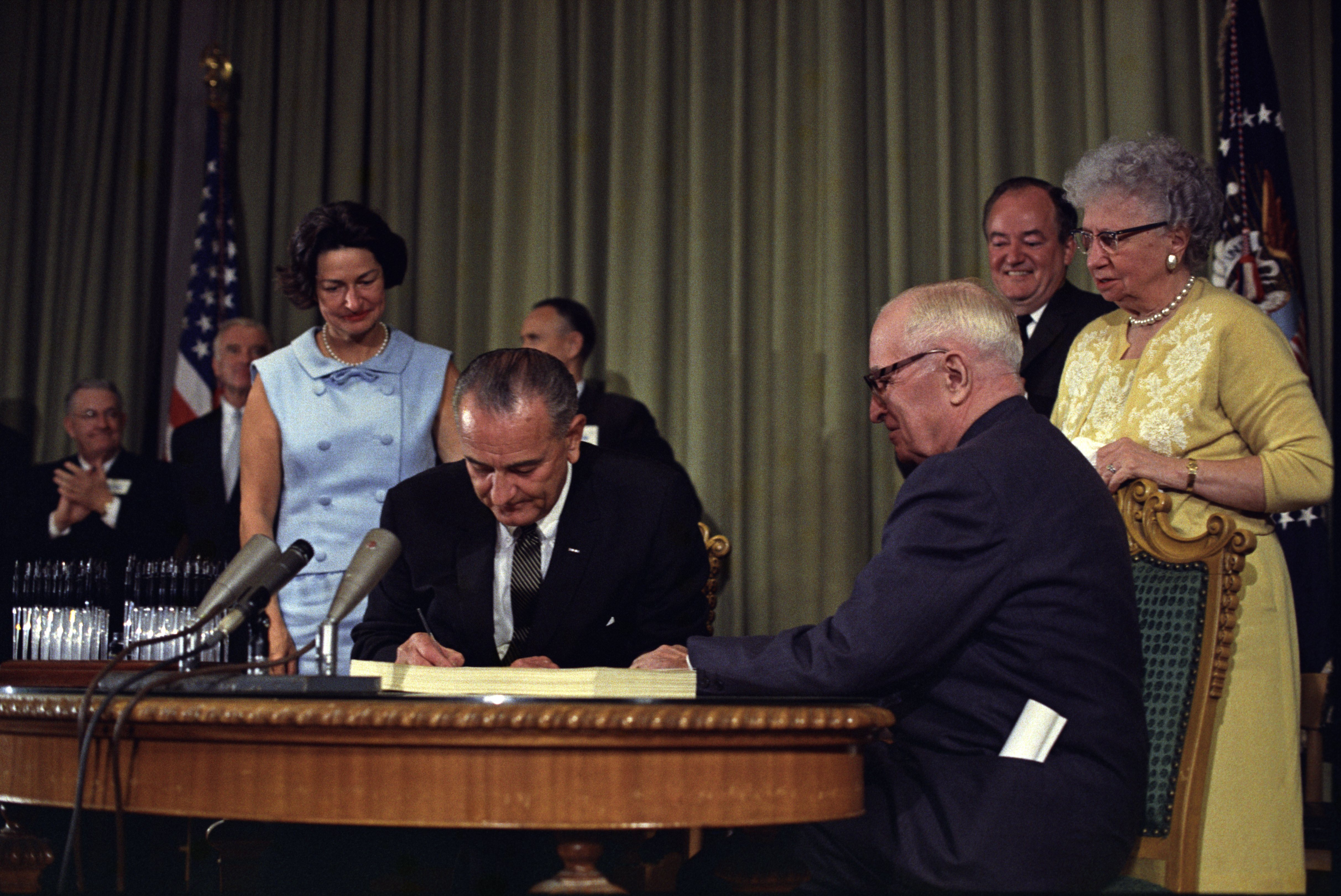 President Lyndon B. Johnson signing the Medicare Bill at the Harry S. Truman Library in Independence, Missouri.