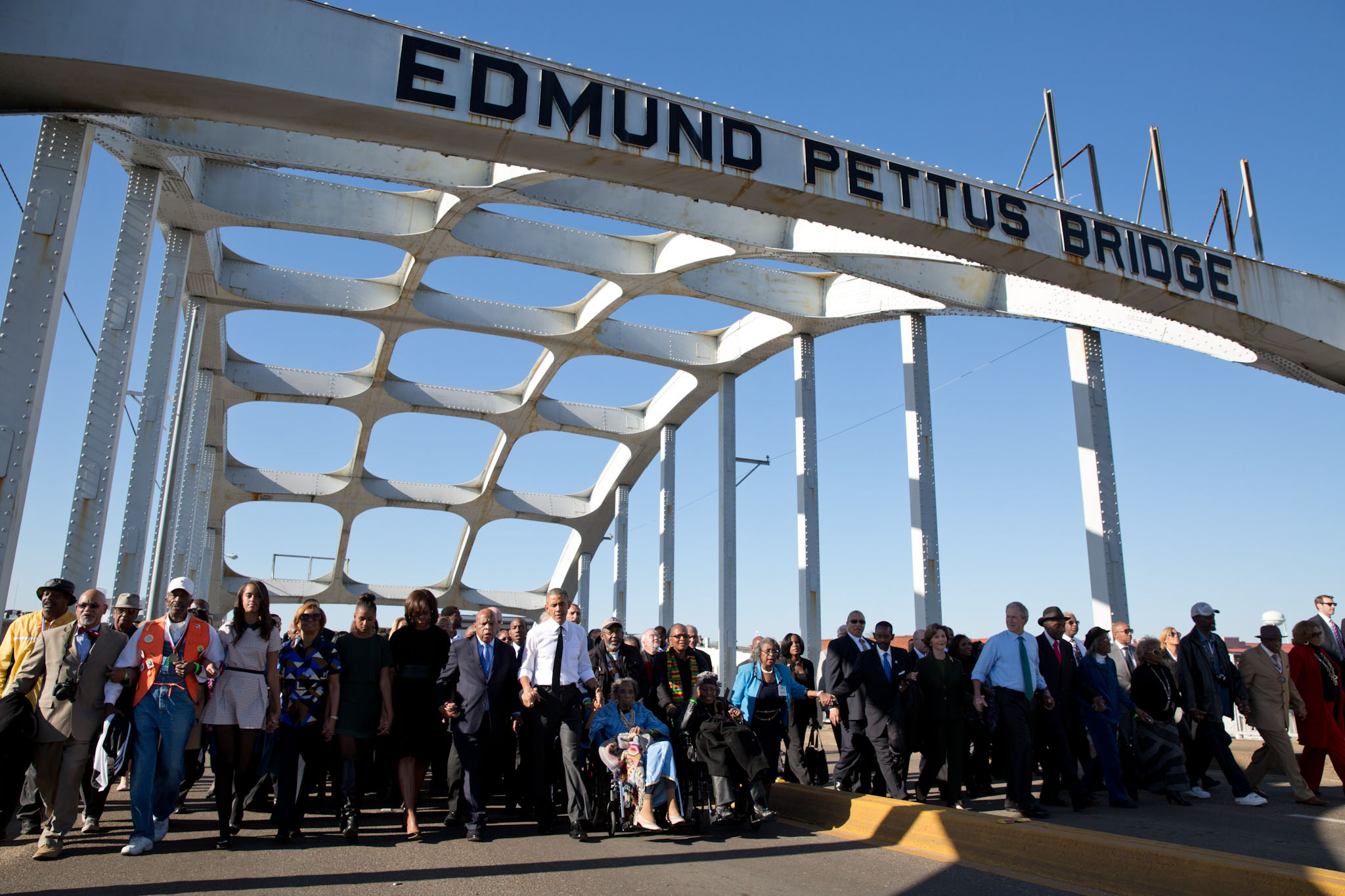 President Obama, family, and many others walking across the Edmund Pettus Bridge to commemorate the 50th Anniversary of Selma .