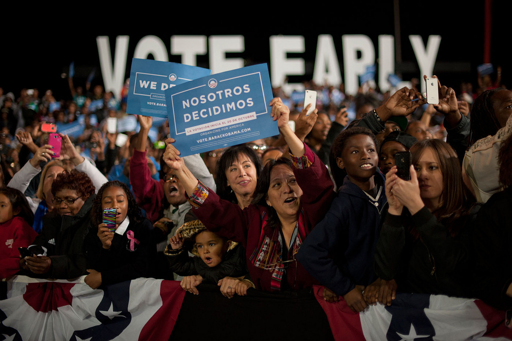 Supporters hold a Spanish-language rally sign at an Obama-Biden 2012 event in Las Vegas
