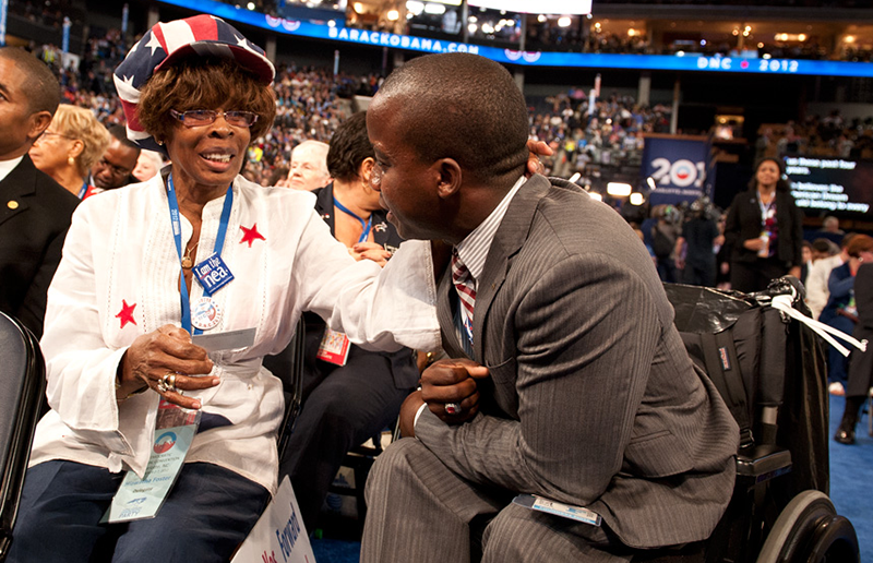Two people talking during the Democratic National Convention.